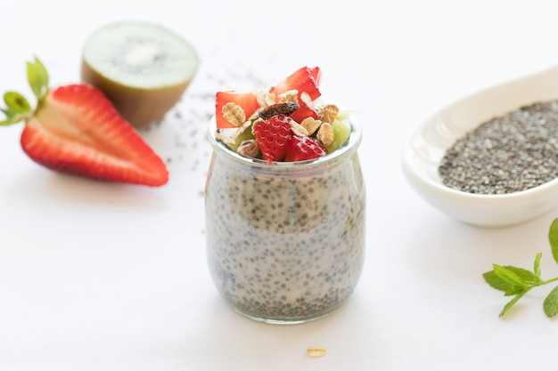 Healthy vegan chia pudding in a jar with fresh berries
