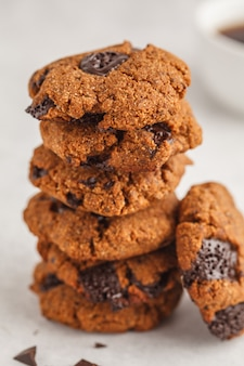 Healthy vegan cookies with chocolate, white background. clean eating concept.