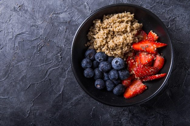 Healthy vegan diet salad quinoa with blueberry,strawberry, honey and chia seeds.