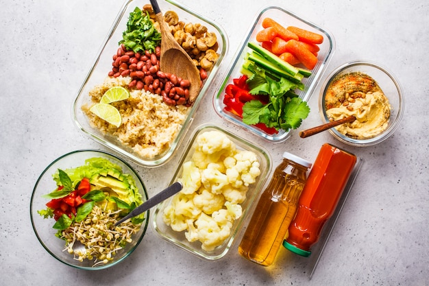 Healthy vegan food in glass containers, top view.