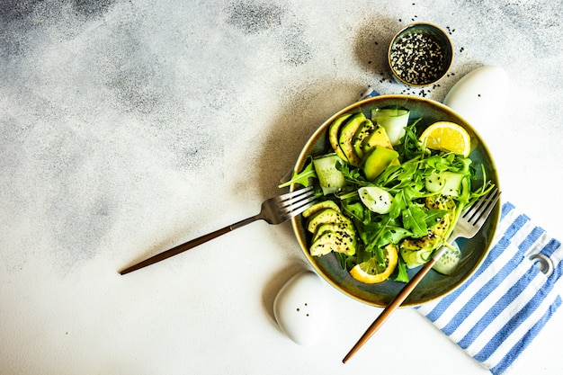 Healthy vegetable salad with aragula and avocado