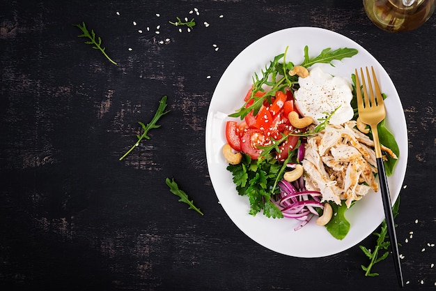 Healthy vegetable summer salad, fresh vegetables and chicken breast with yogurt dressing. keto, ketogenic diet. top view, above, copy space