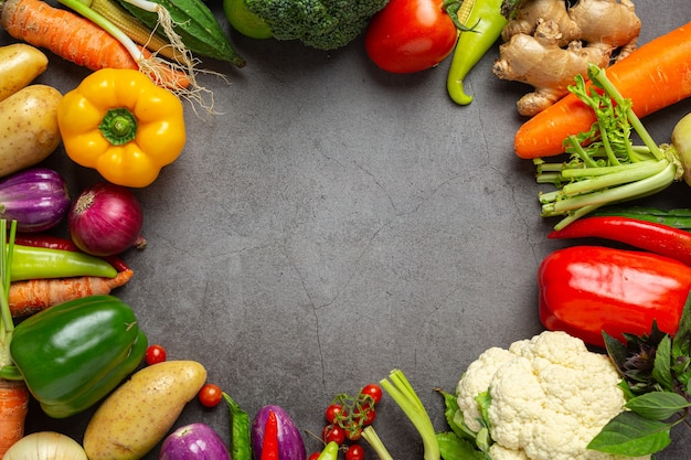 Healthy vegetables on old dark background