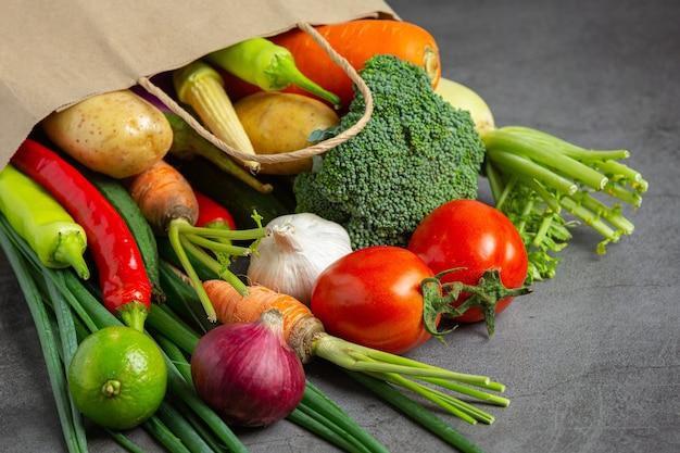 Healthy vegetables on old dark background