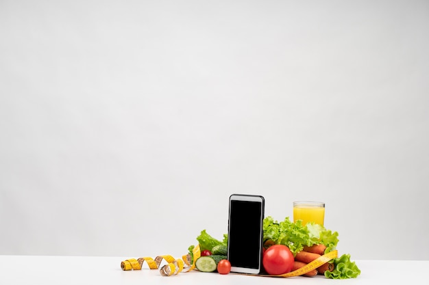 Healthy vegetables and phone copy space