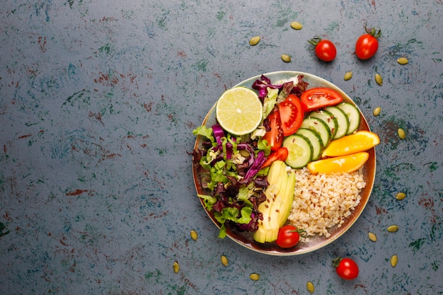 Healthy vegetarian balanced food concept, fresh vegetable salad, buddha bowl