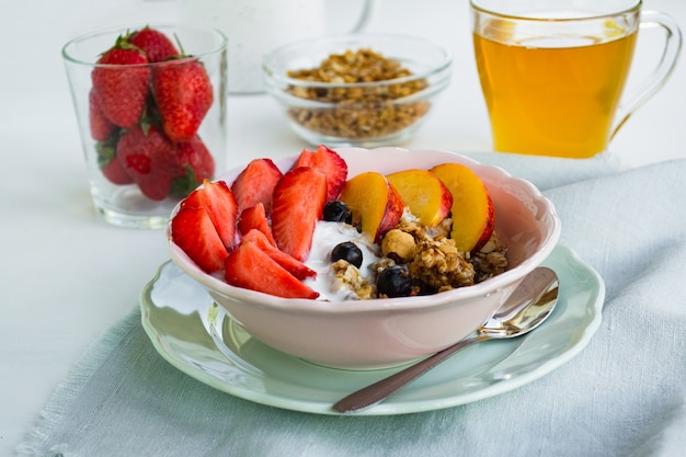 Healthy vegetarian breakfast. a bowl of granola, berries and fruit