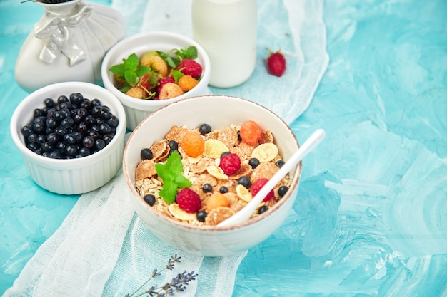 Healthy vegetarian breakfast with berries and cereal