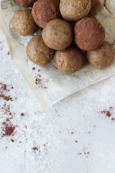 Healthy vegetarian energy balls with chickpea, peanut butter, raisin and cocoa powder