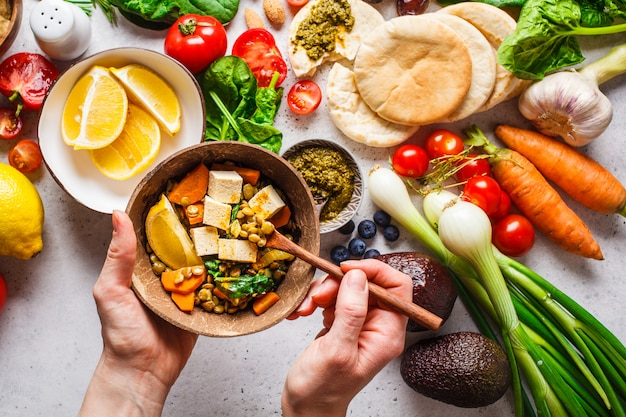 Healthy vegetarian food background. vegetables, pesto and lentil curry with tofu.