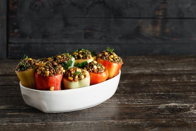 Healthy vegetarian food stuffed peppers lentils corn salsa copyspace