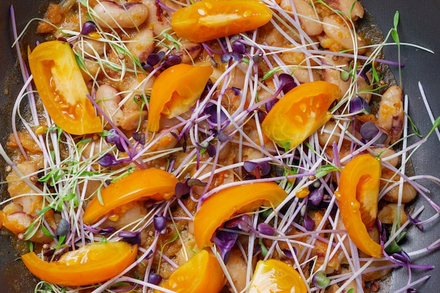 Healthy vegetarian foods with yellow tomatoes, beans and microgreens. healthy, clean eating, weight loss, dieting food concept