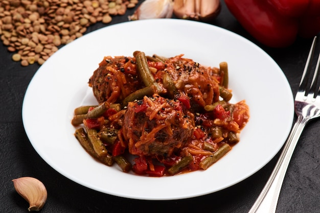 Healthy vegetarian lentil meatballs with tomato sauce and vegetables