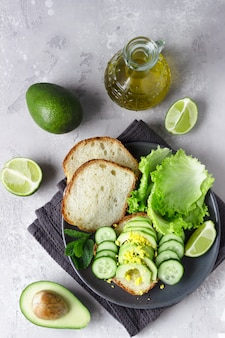 Healthy vegetarian sandwich with no knead homemade bread, avocado and cucumbers