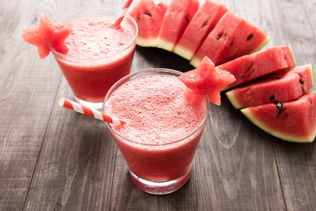 Healthy watermelon smoothie with of watermelon in star shape on a wood table.