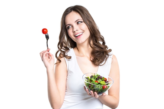 건강 한 여자와 손에 샐러드