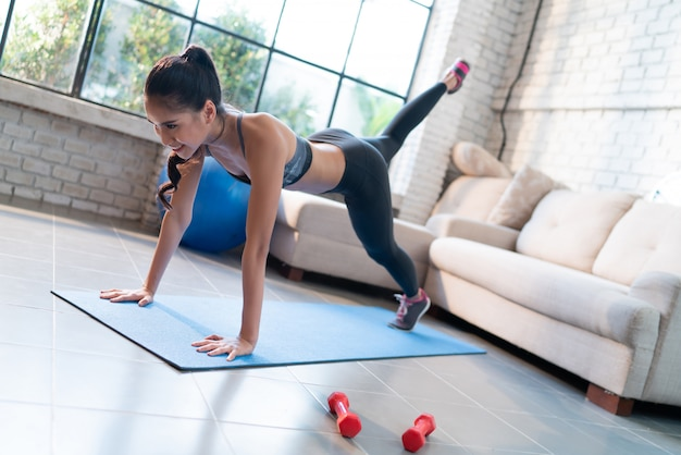 Healthy woman exercises at home