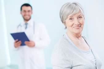 Healthy woman in doctor's office