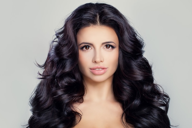 Healthy woman with clear skin and long curly hair perfect face and hairstyle