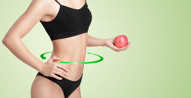 Healthy woman with a red apple.