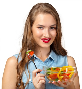 Healthy woman with salad on white