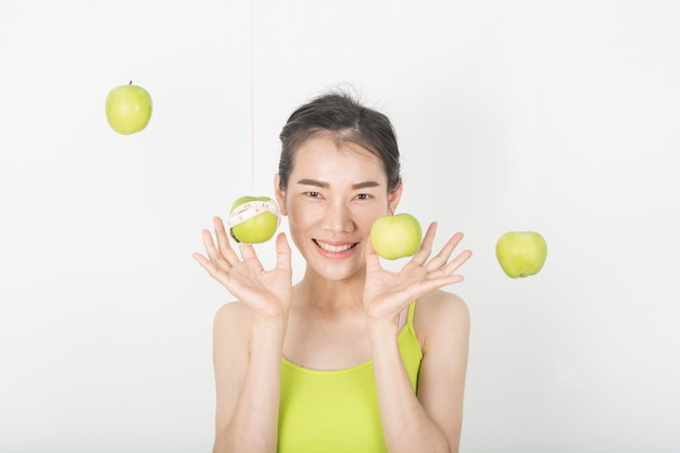 Healthy women with green apples in the white scene Premium Photo