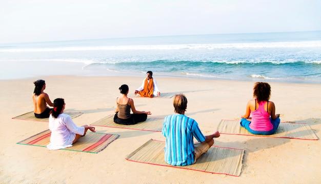 Healthy yoga class on the beach