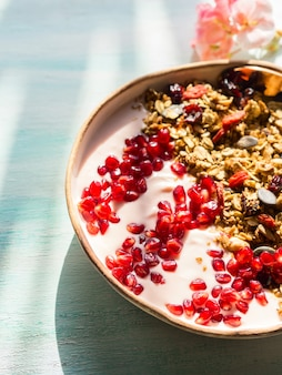 Healthy yogurt bowl with granola and pomegranate