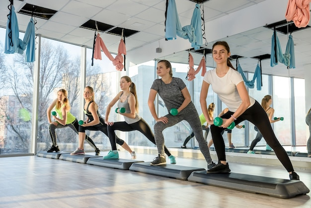 Healthy, young group of women doing exercises in gym
