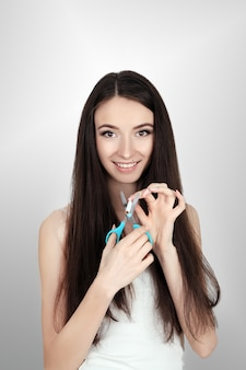 Healthy young woman refusing to take cigarette from pack. portrait of beautiful female showing stop sign with hand to cigarettes. quit smoking concept.