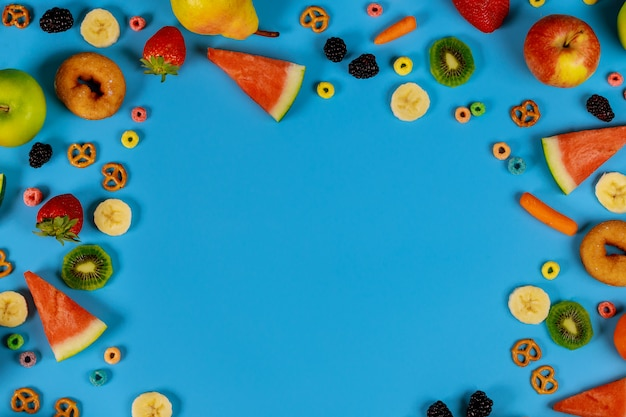 Healty food concept. assortment fruits and vegetables on blue background.