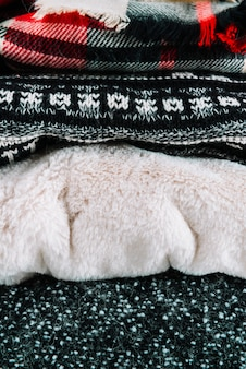 Heap of autumn and winter knitted clothes