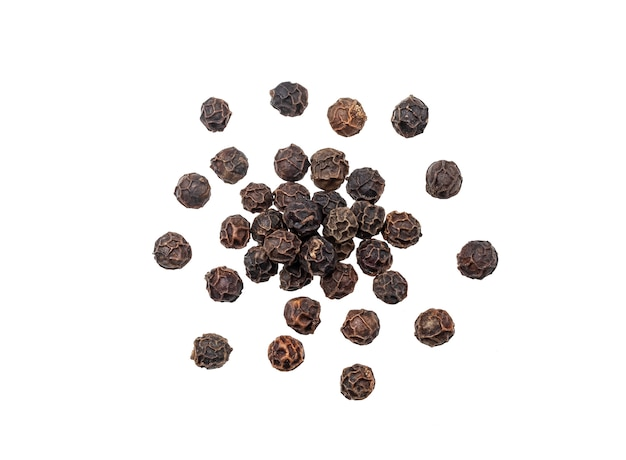Heap of black pepper isolated, macro, top view