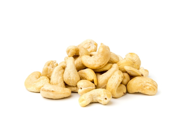 Heap of cashews on a white surface, isolated