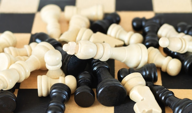 Heap of chess pieces on chess board top view