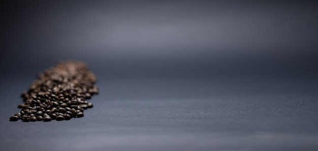 Heap of coffee beans on black background. coffee beans pile isolated on black background. culinary coffee background.