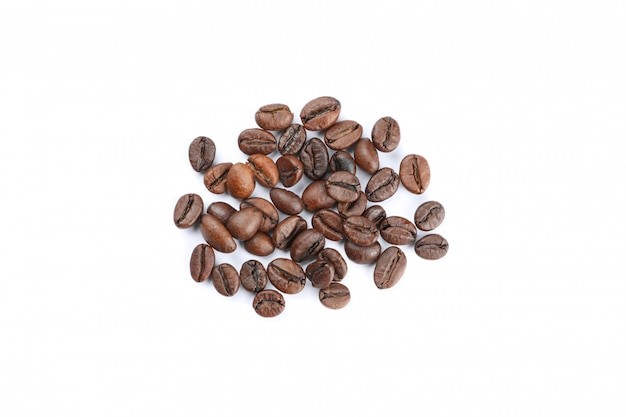 Heap of coffee beans isolated on white background, top view