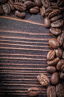 Heap of coffee beans on vintage wooden board