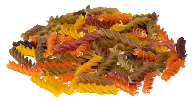 Heap of colorful fusilli pasta isolated on white background.