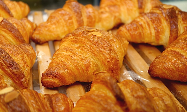 Heap of delectable fresh baked croissant pastries at the bakery