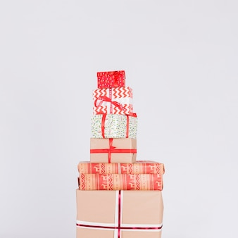 Heap of different present boxes in wraps