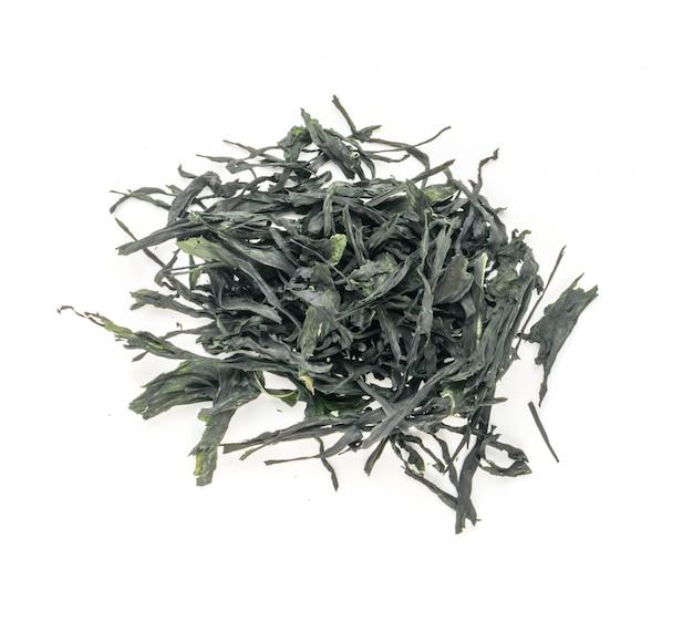 Heap of dry wakame seaweed isolated on white background. healthy algae food