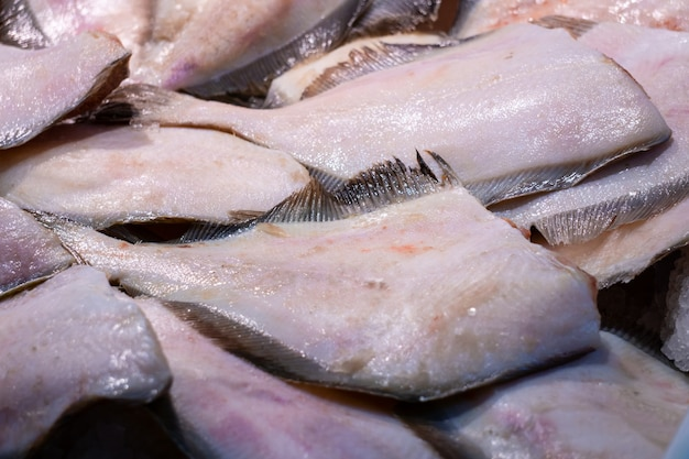 A heap of fresh flounder fillet on the fish market