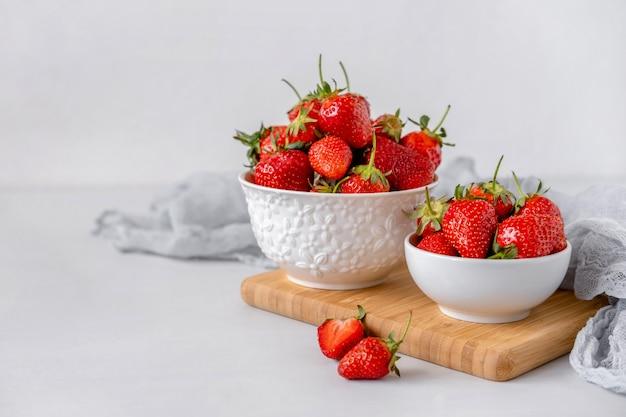 Heap of fresh strawberries in ceramic bowl