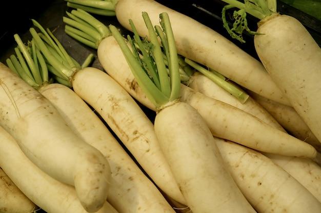 Heap of fresh white radish or daikon radish