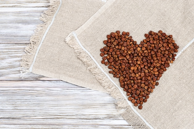 Heap of grains of legumes bean seeds in heart shape
