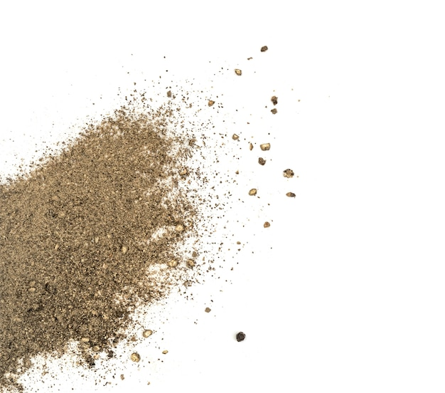 Heap of ground black pepper isolated on white top view. spice looks like scattered sand flat lay and top view