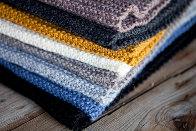 Heap of hand  knitted wooden scarves.