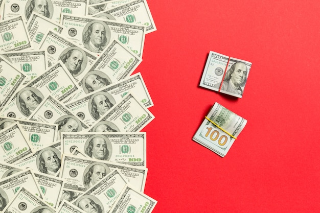 Heap of hundred dollar bills top view, with empty place for your text business money concept