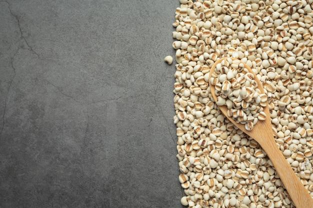 Heap of millet seeds on dark background